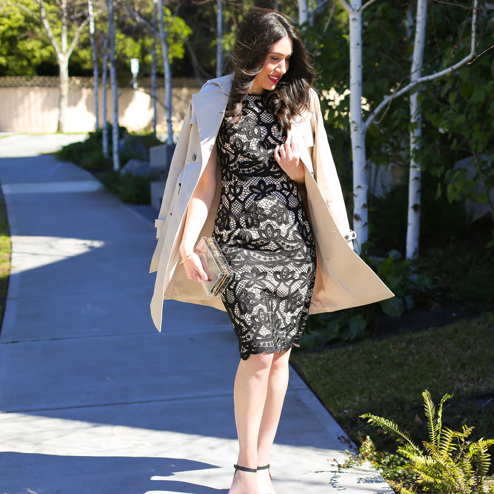 Lisa wears  David Lawrence Ravenna Bonded Lace Sleeveless Dress and  Astor Trench Coat