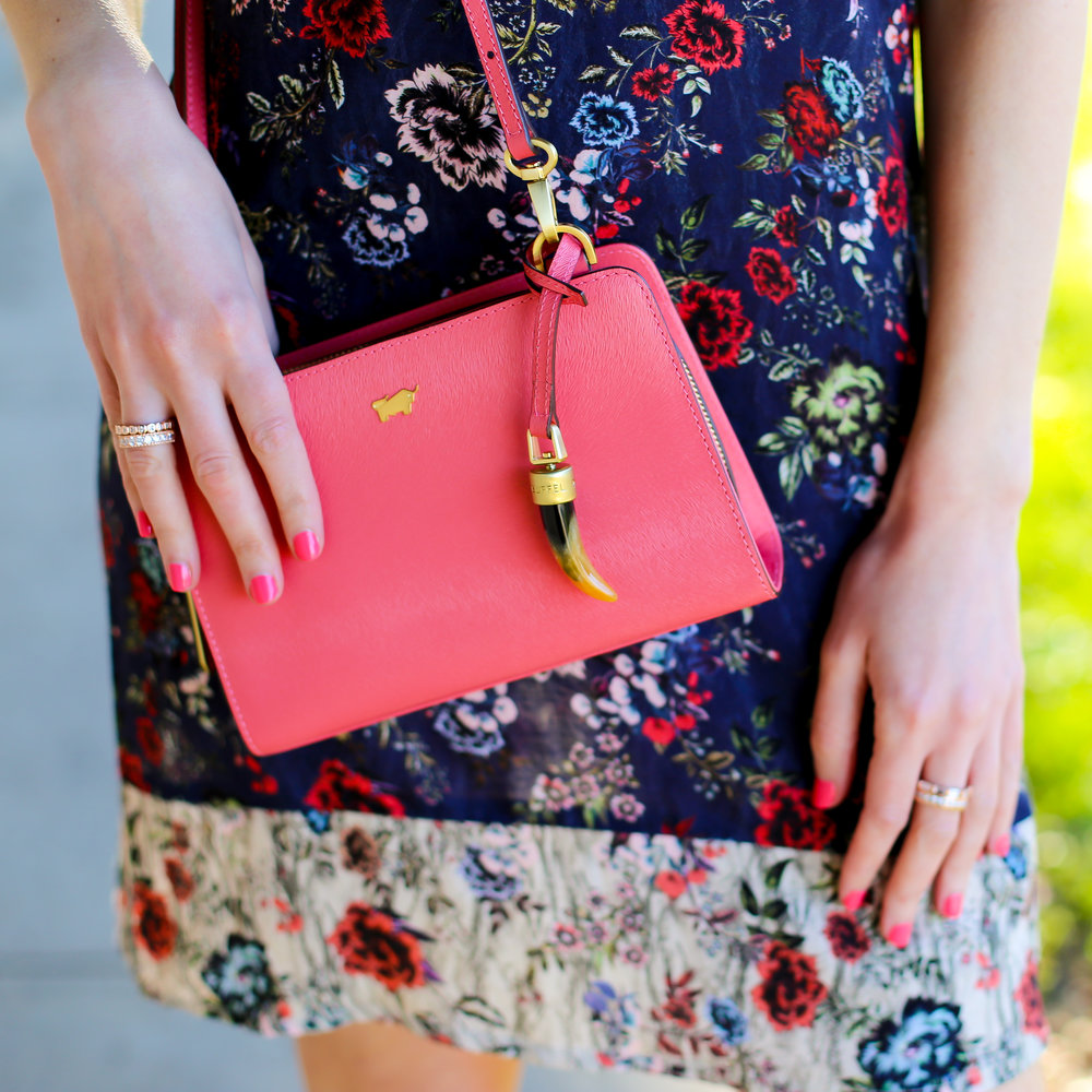 Jewellery by  Sophie Catherine Jewellery ; bag by  Braun Buffel ; dress by  Indigo .
