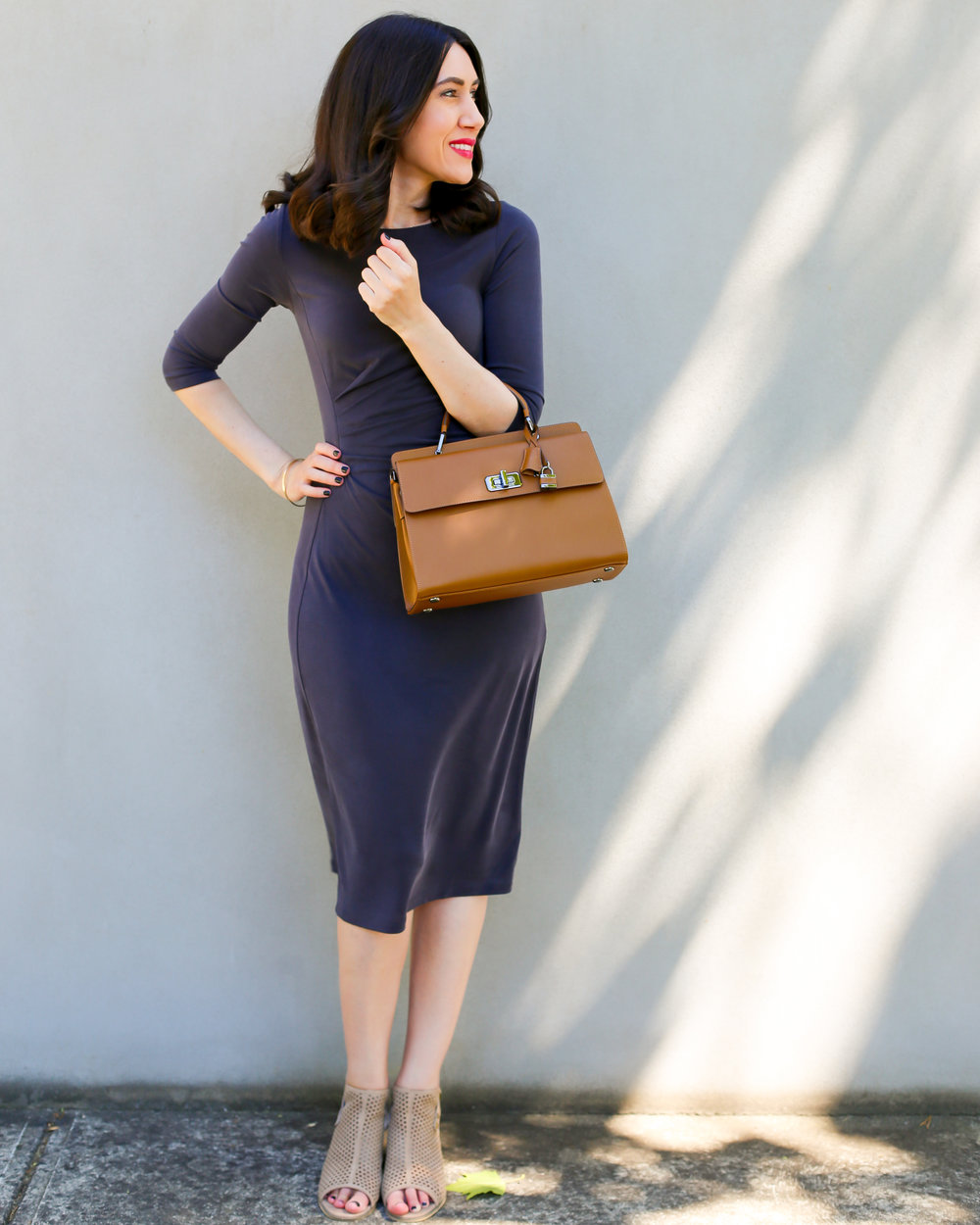 Lisa wears  Saba Penelope Drape Dress ,  Mollini Shoes  &  Braun Buffel Bag .
