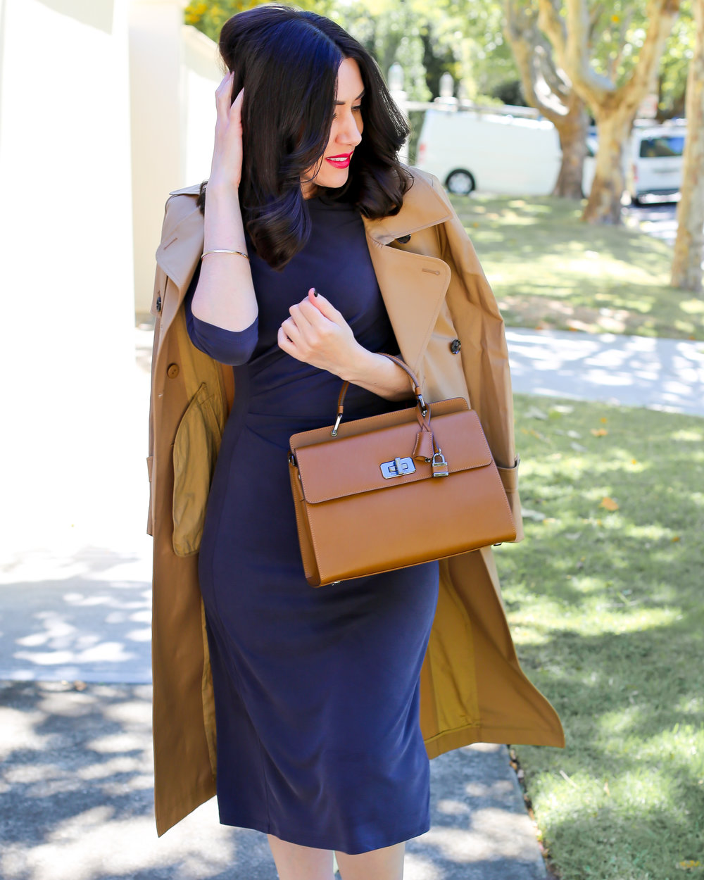 Lisa wears Saba  Brooklyn Trench Coat &  Penelope Drape Dress ,  Braun Buffel Bag