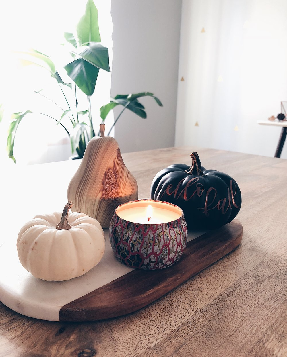Sources:  Marble Tray (Similar)  /  Voluspa Candle  / Faux Wood Pear: Target / Black Faux Pumpkin: Target / White Pumpkin: Trader Joe's