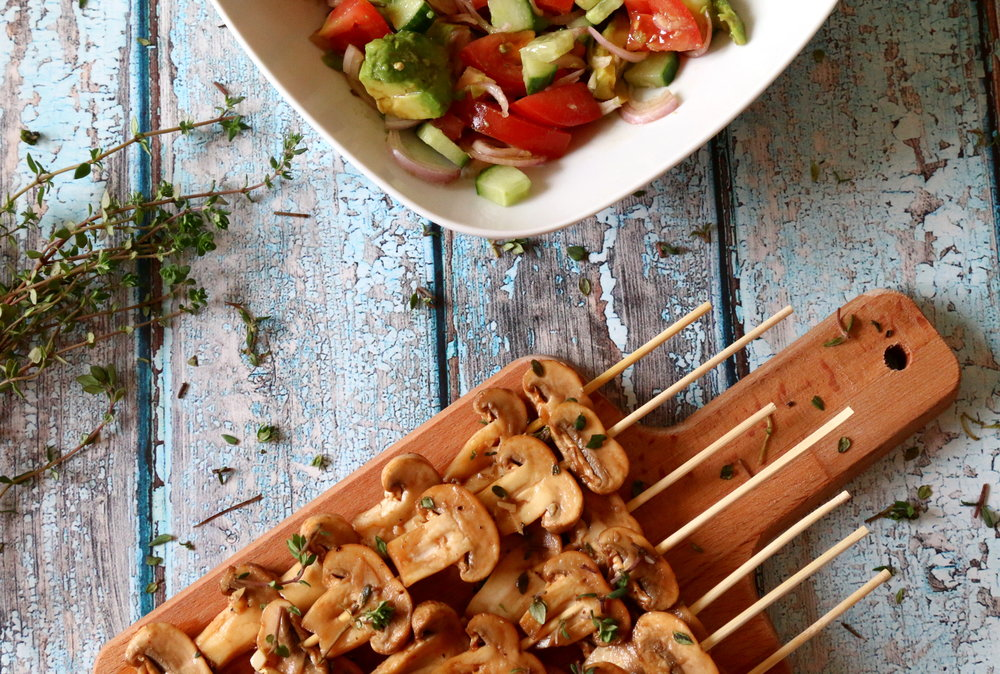 marinated mushrooms skewers with fresh salad