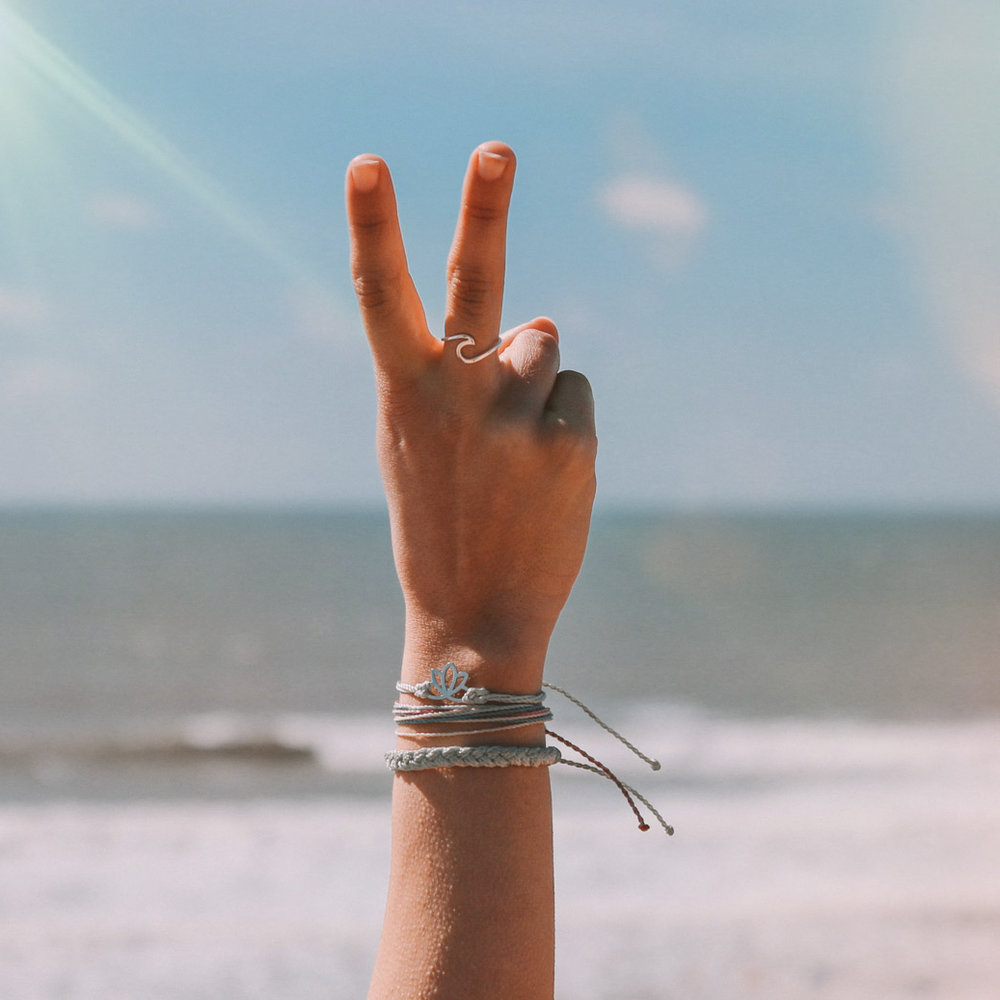 bracelet lotus flower pura vida ethical fair trade girl sea sunset photography happiness live in the moment beautiful travel explore
