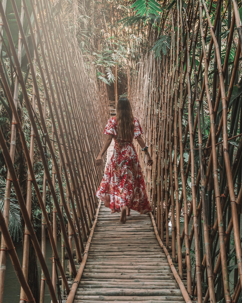 Sunset romance at bambu indah jungle tent bamboo bridge girls love travel best hotels in bali ubud