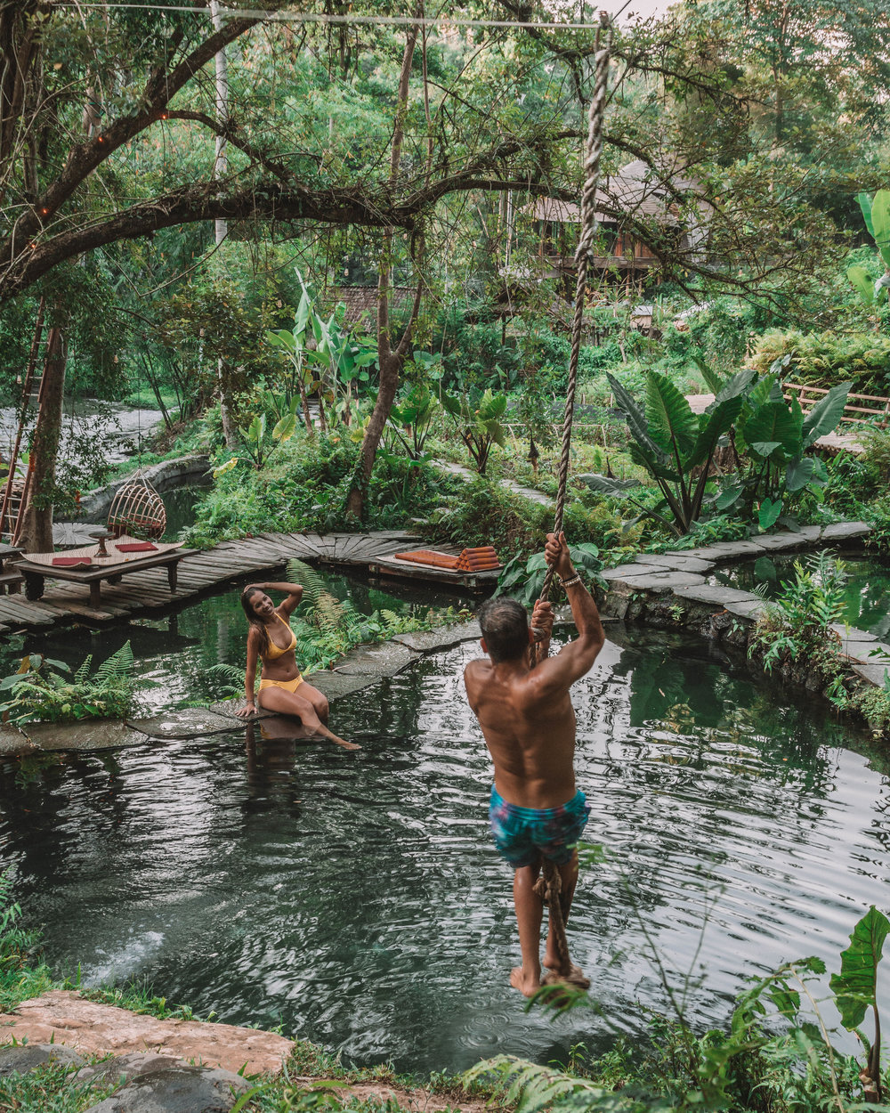 Sunset romance at bambu indah jungle tent natural pool swing adventure couple fun love freeoversea nature vibes best hotels bali ubud