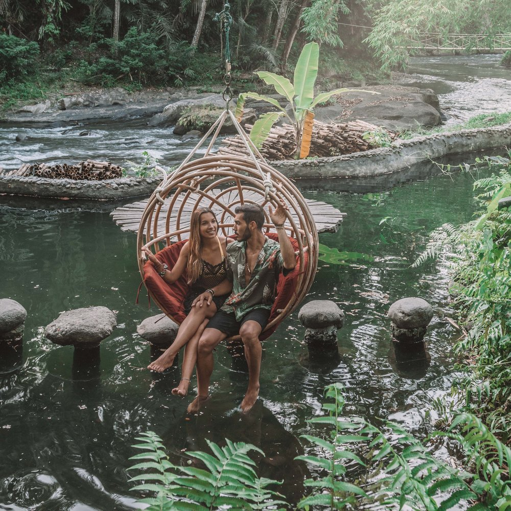Sunset romance at bambu indah jungle tent swing goals travel couple freeoversea