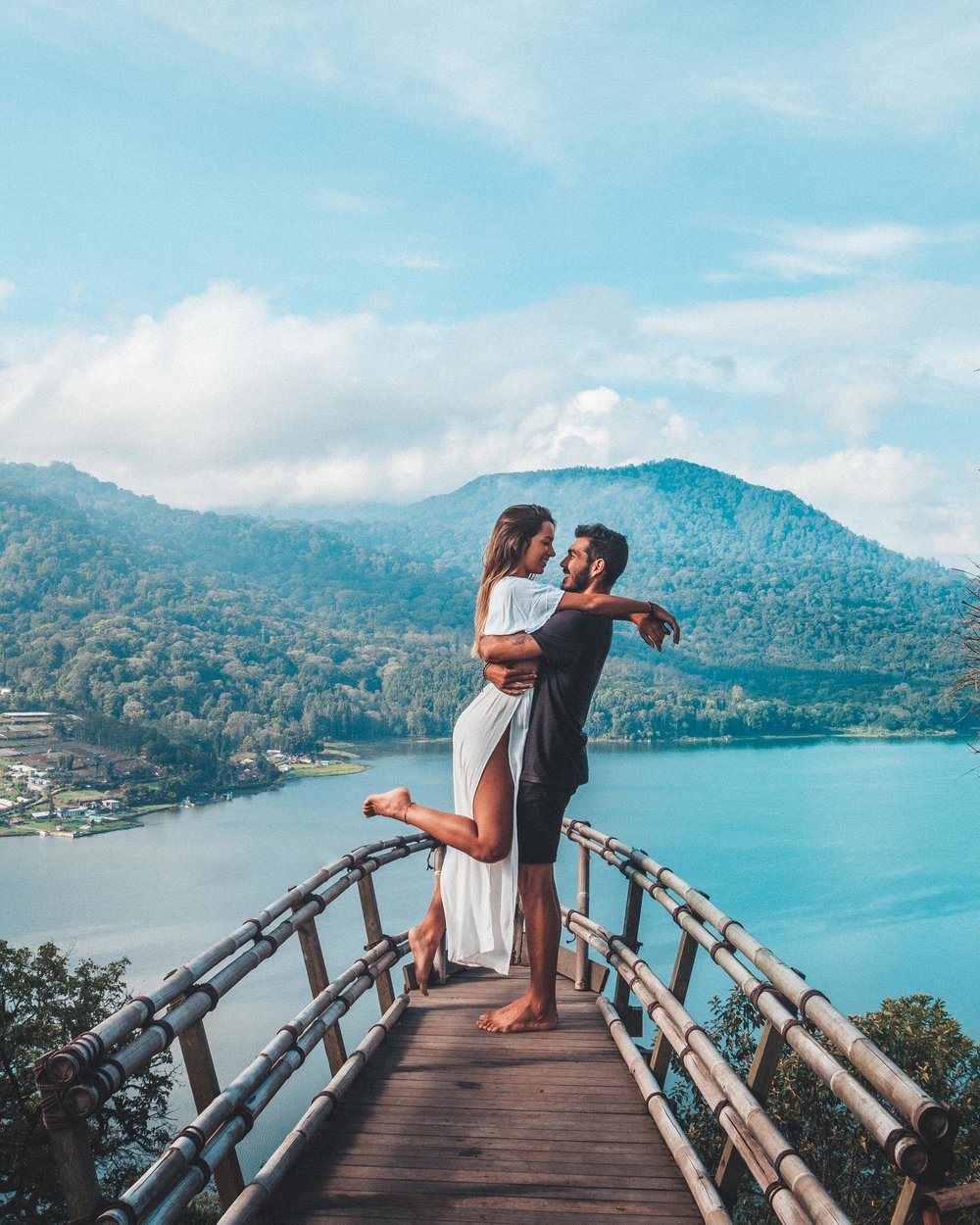 freeoversea travel couple boat munduk lake view swings bali indonesia asia