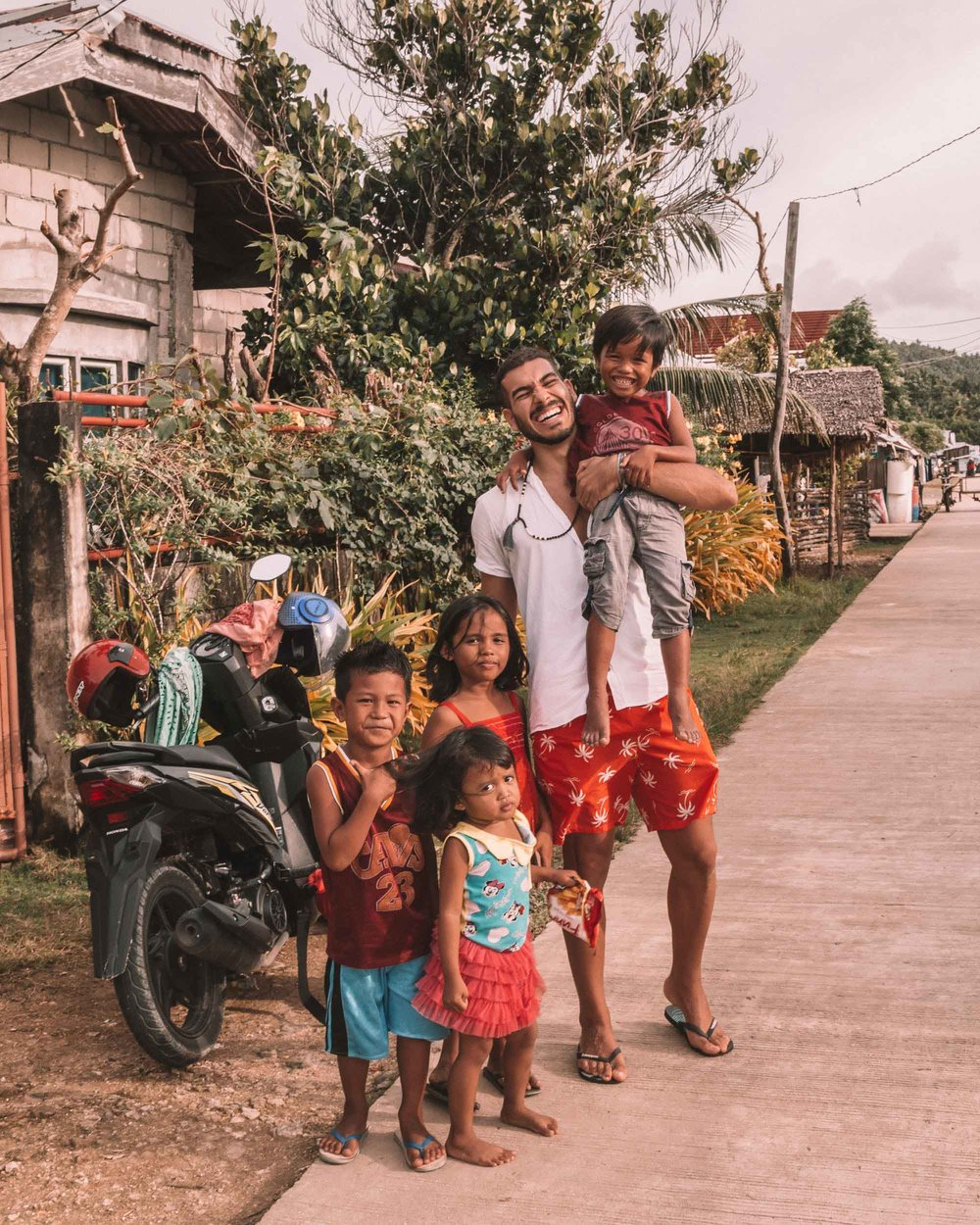 Siargao living the ultimate island life Philippines tropical destination palm tree beach beautiful places travel guide local children playing