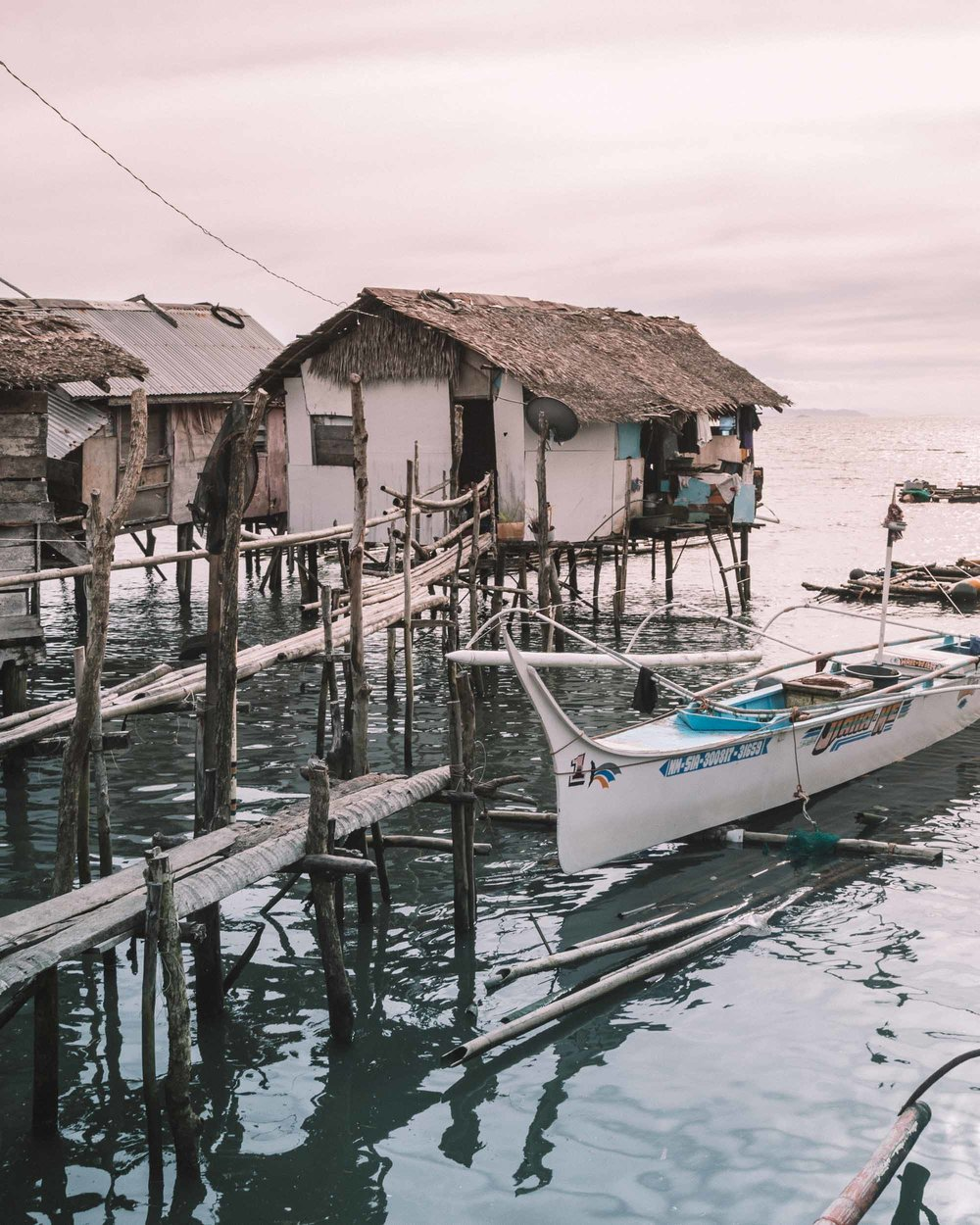 Siargao living the ultimate island life Philippines tropical destination palm tree beach beautiful places travel guide santa monica pier sunset fishing village