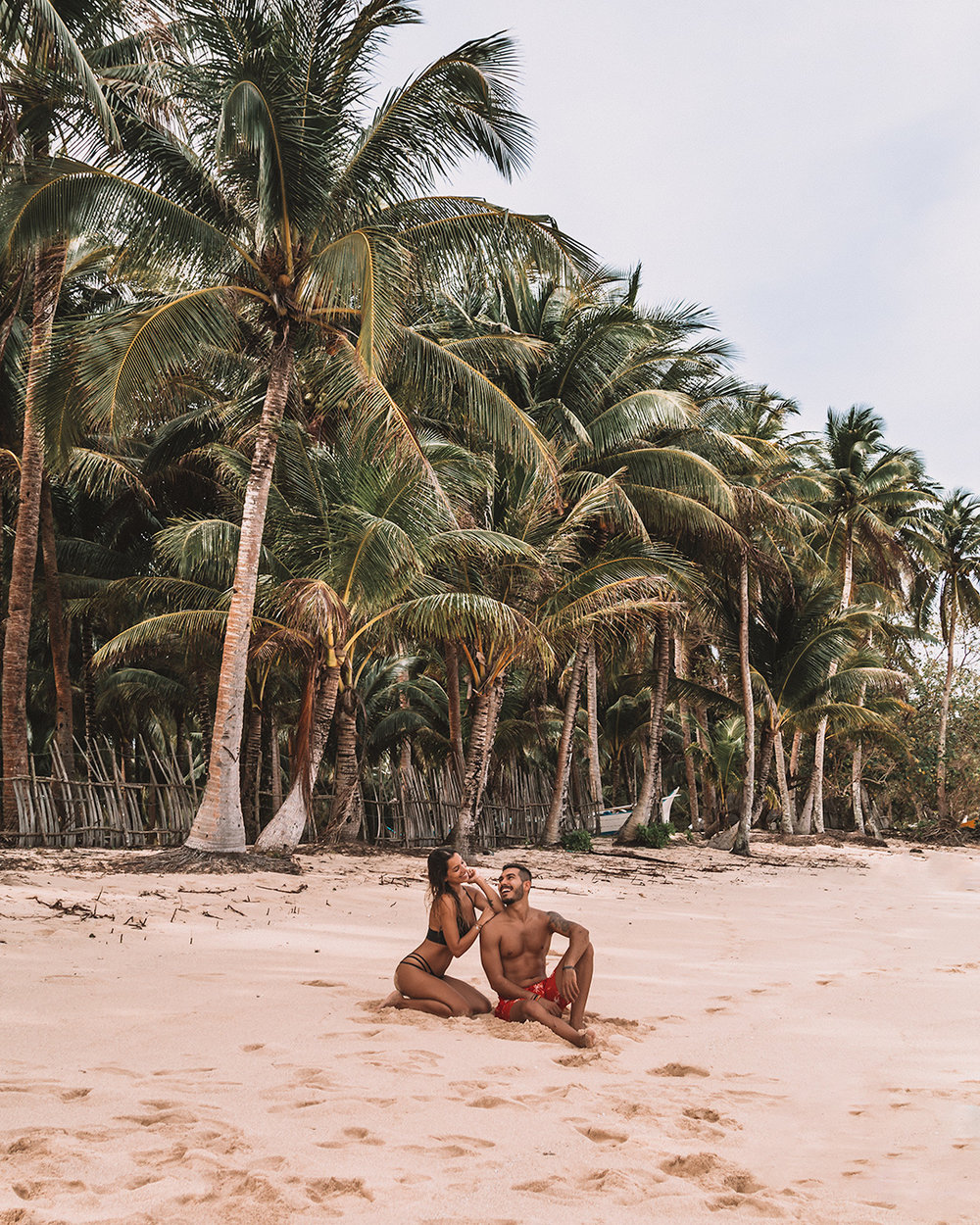 Siargao living the ultimate island life Philippines tropical destination palm tree beach beautiful places travel guideAlegria Beach most beautiful beach in Siargao