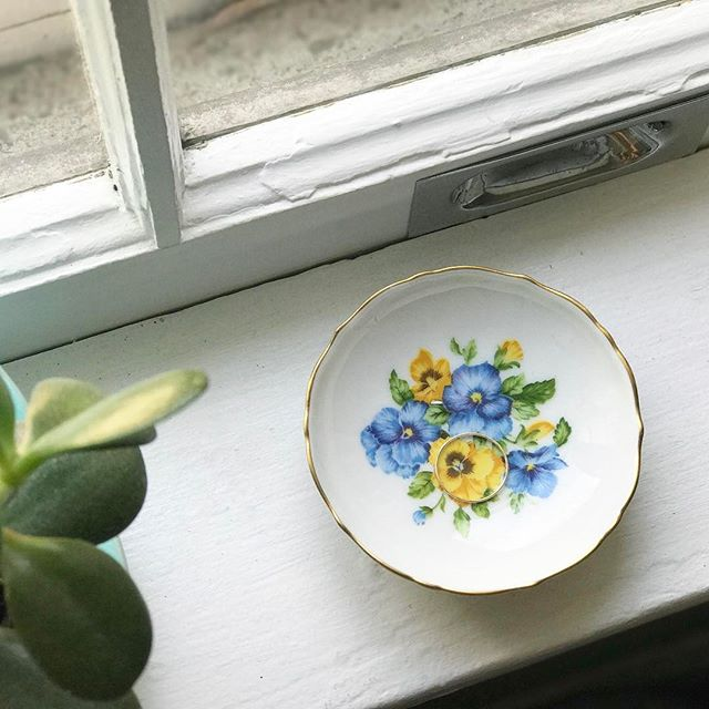 "our petite pansy ring dishes are so sweet we had to keep one for ourselves. 🌼🌿 2 are in the shop. $8 ea. link's in our profile to make yours. . let your rings rest easy with one of these sweet little dishes. . perfect to place on your bedside table, by the bathroom sink, or in the kitchen. . the gold rim accent is so lovely, adding just a touch of glimmer. . pansies symbolize the love or admiration of one person for another 💛. . measures: 3"" in wide, .75"" deep (fits in the palm of your hand)"