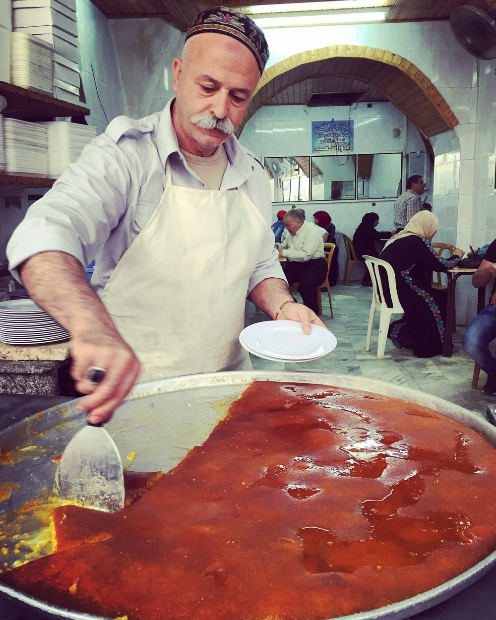 NABLUS | The famed al-Aqsa kanafe shop, a family owned institution in the old city of Nablus. I asked what makes the Naboulsi version unlike any other, everyone said it was the fresh spring water used to make the cheese. May 5, 2016.