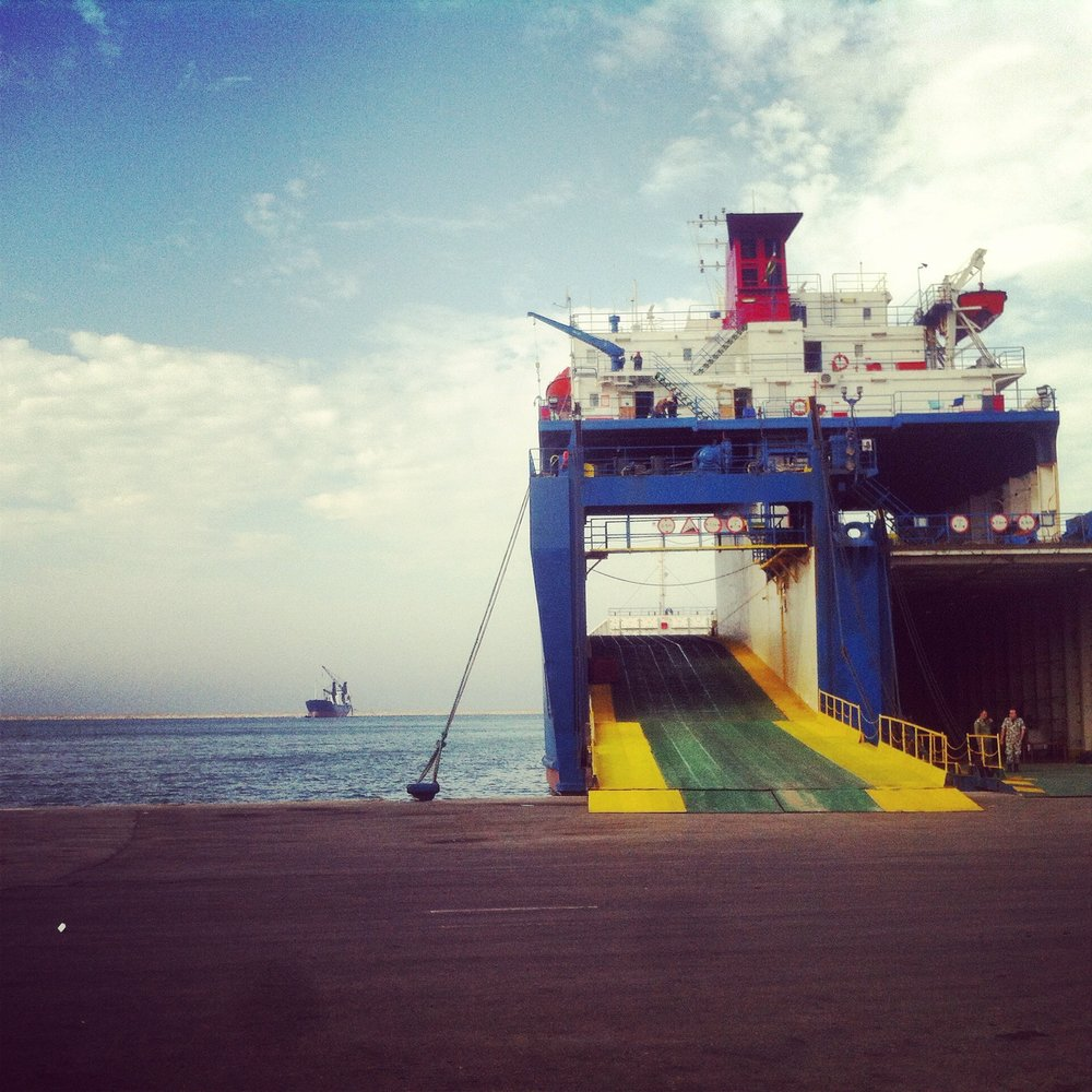 TRIPOLI | The view from Tripoli's port. Before the Syrian uprising in 2011, nearly 300,000 tons of cargo was docked from Eastern Europe on this harbor, most of this is transferred to Syria and Iraq by truck. Today a few courageous truck drivers still make the perilous journey through war zones and ISIS territory. December 5, 2014.
