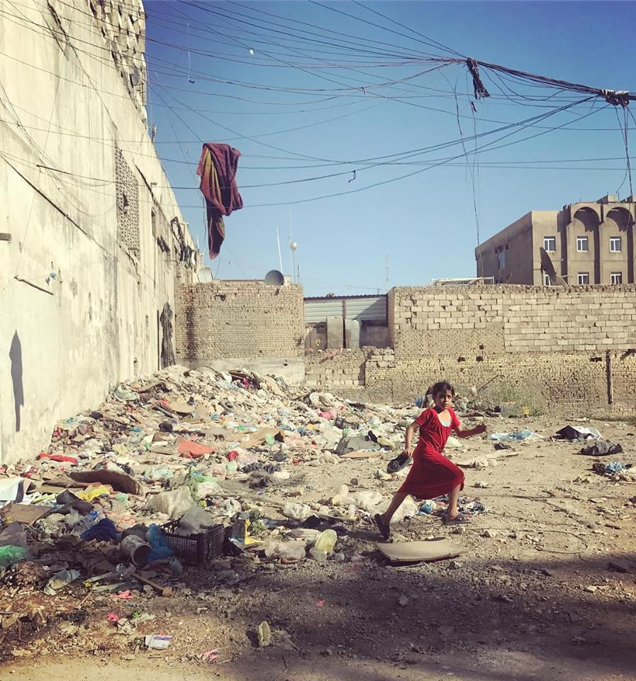 BAGHDAD | A girl skips down the residential street of Karada, in the capital. April 23, 2018.