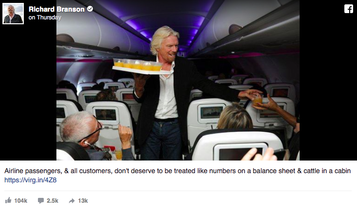 Richard Branson's Facebook post of him serving drinks to his passengers.