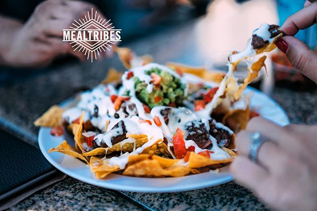 Who would you share these loaded Nachos with?! Haven't been to a potluck yet? It doesn't matter if you come alone or bring a friend you'll feel welcome. #findyourtribe #mealtribes