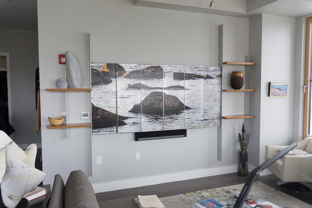 Folding screen to hide TV with image overlay and side shelving