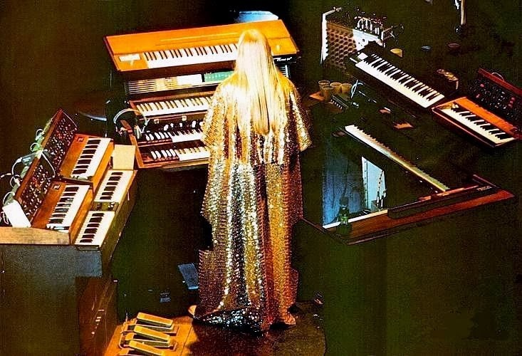 Rick Wakeman on stage in the 1970s with a plethora of keyboards