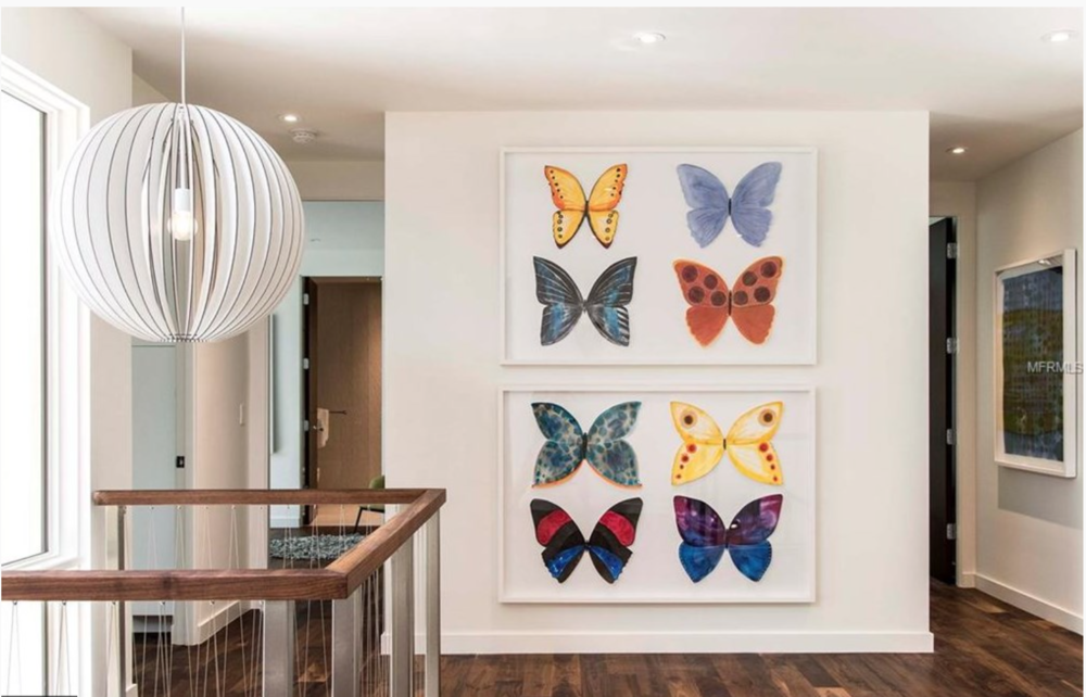 """Second Floor balcony wall:  """"8 Butterflies""""  Handpainted, hand-cut 3-dimensional paper butterflies framed in the likeness of specimen boxes. $7995. for the pair."""
