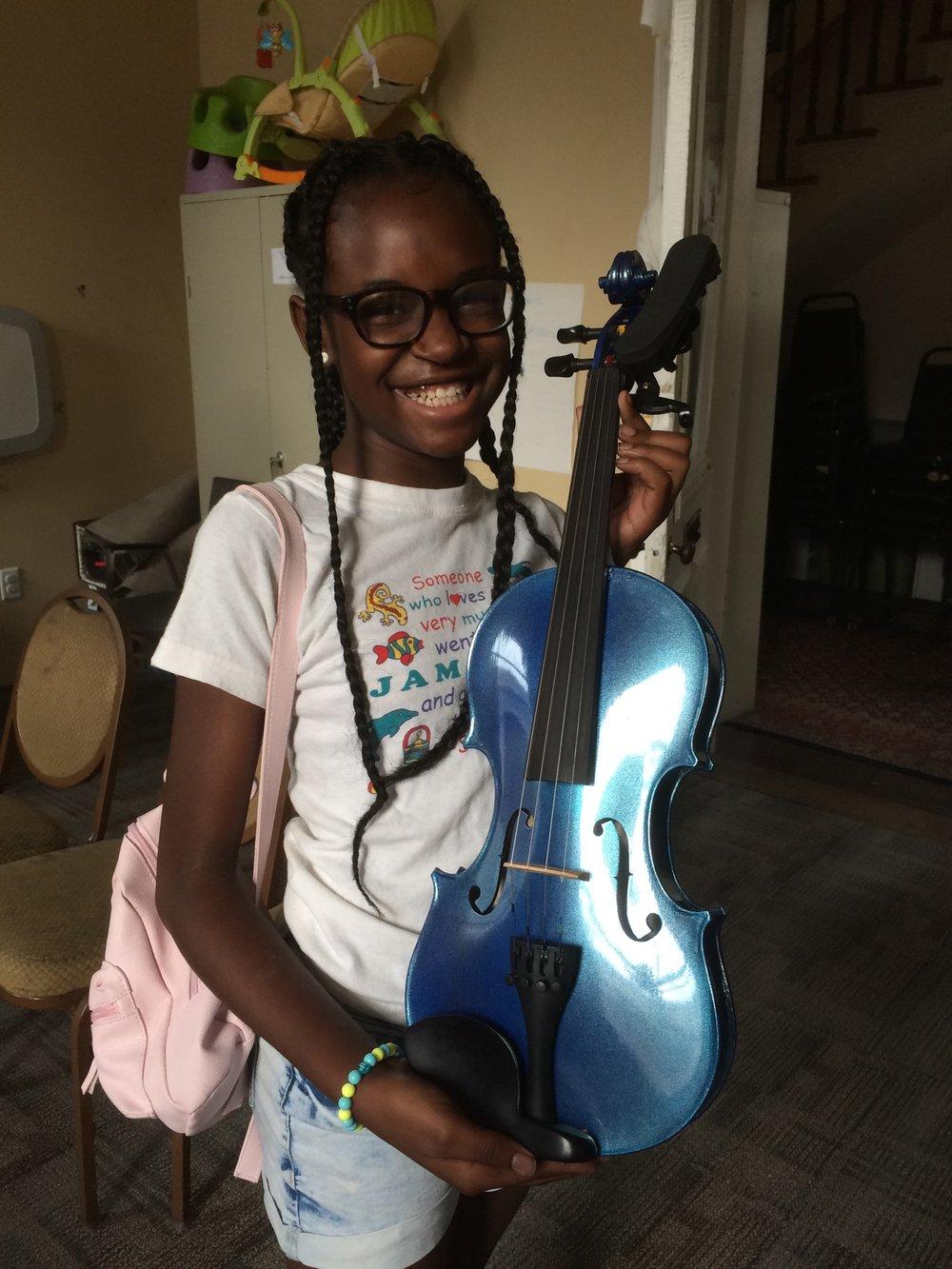 Tierra with violin donation.jpg