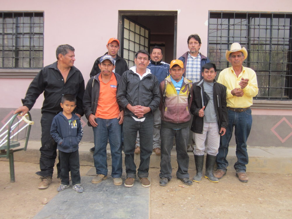 Left to Right: Adalid (with son Hansel), Mancho, Disney, Don Roman, Patrocinio, Benito, Hector, Edwin, and Don Chico (not pictured from the meeting: Don Polo and Ariel)