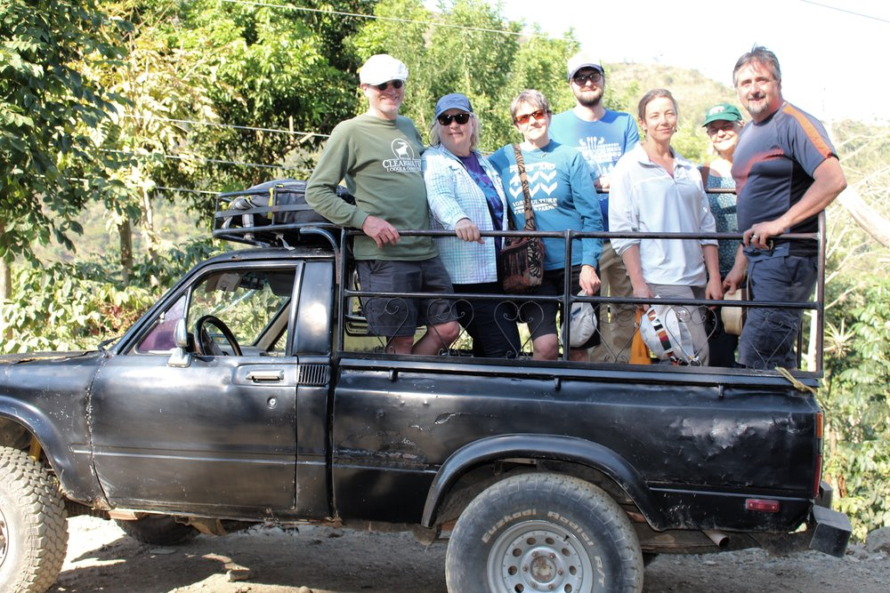 10 Traveling to the coffee fields in back of pick up.jpg