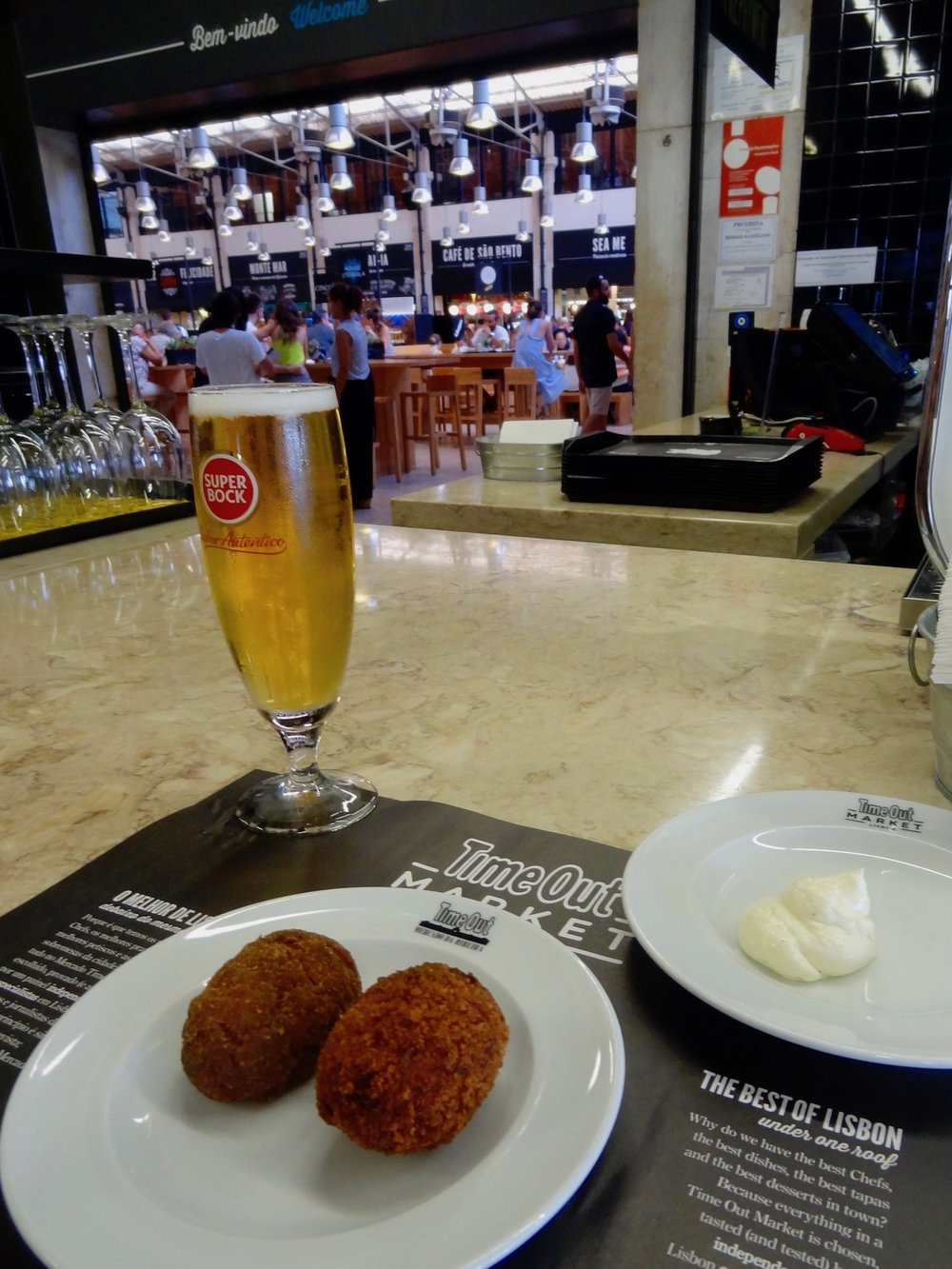 sampling  croquetes  at time out market, lisbon