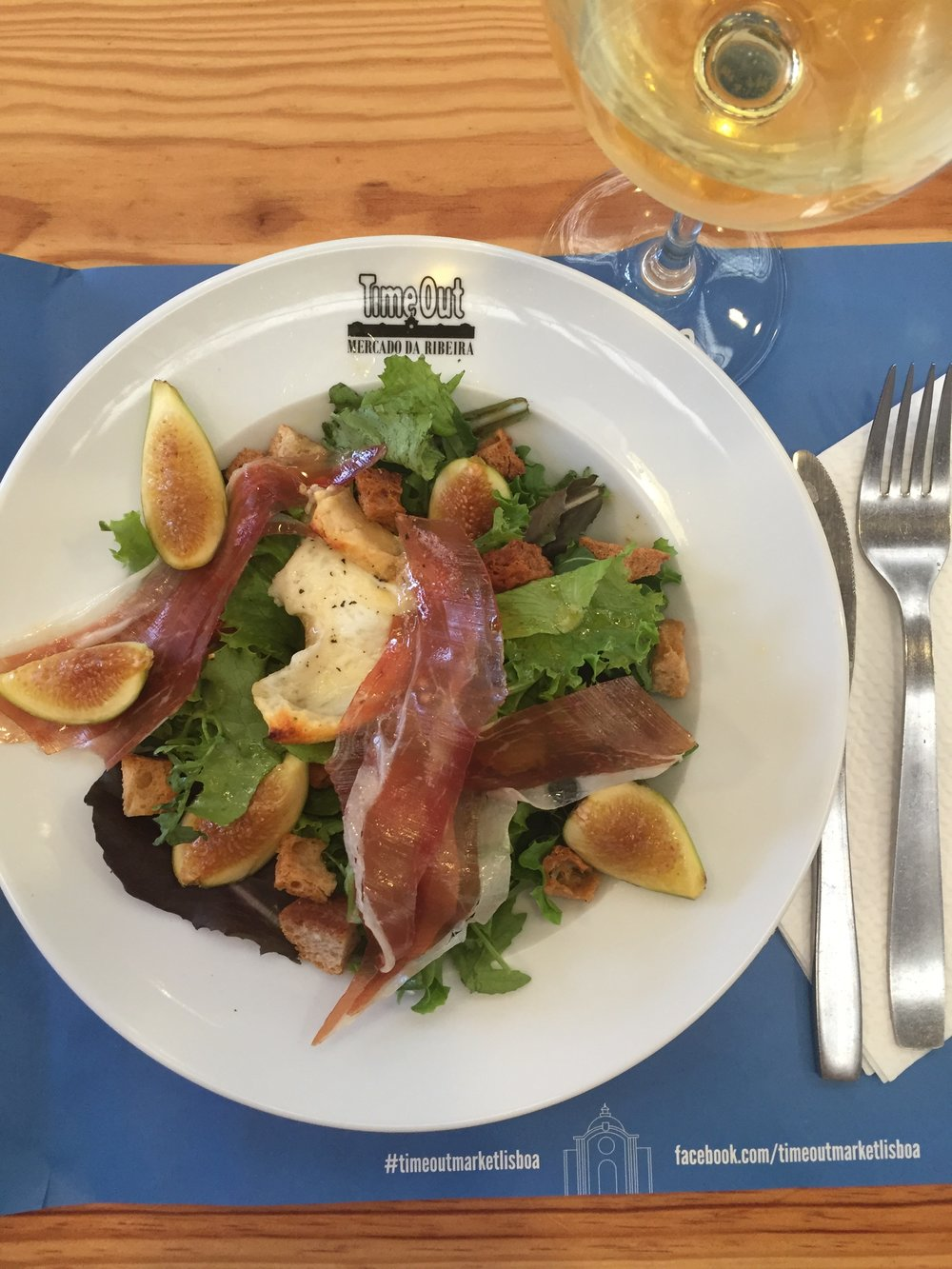 beautiful salad with figs, goat cheese, and prosciutto