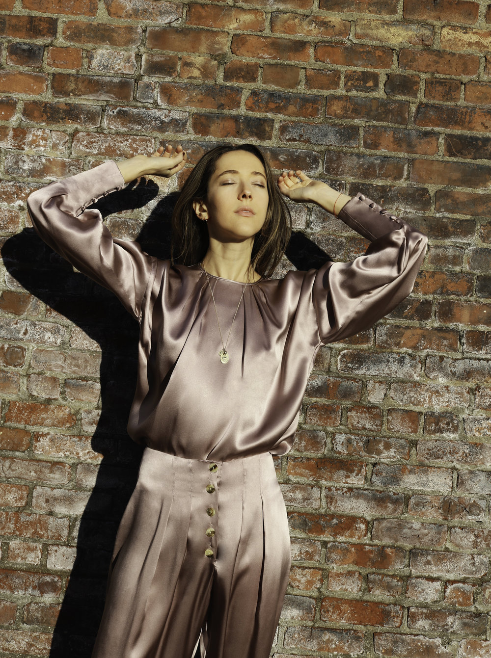 Jessica wearing the     YLVA BLOUSE   and   VEIGA PANT   combined with a Zahava necklace.
