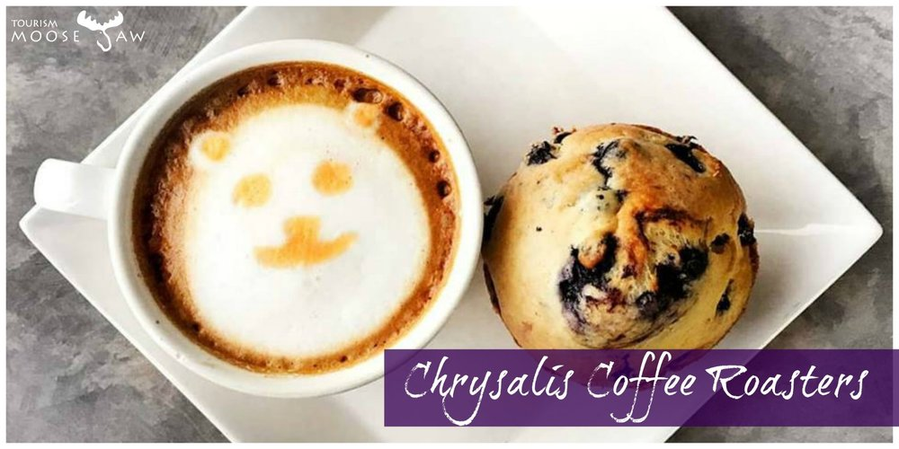 Chrysalis Coffee Roasters  This locally owned coffee shop won't just serve you one of the best cups of coffee around, you can also find delicious hand crafted sandwiches, salads and top notch homemade baking. The location and large windows are perfect for people watching!