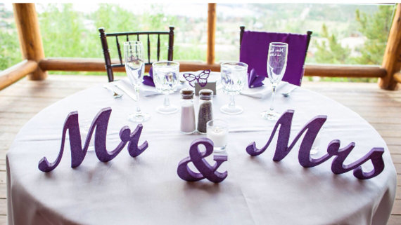 Table Decoration by SunFla, available on Etsy at https://www.etsy.com/listing/198605520/mr-mrs-purple-glitter-letters-wedding.