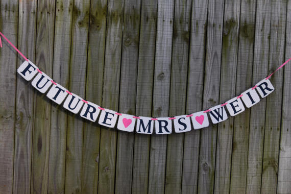 Banner by BannerCellar, available on Etsy at https://www.etsy.com/listing/519915243/future-mrs-banner-bridal-shower-banner