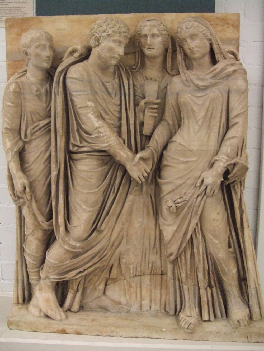 A relief at the British Museum portraying a Roman wedding. Photographed by Sarah Tarnopolsky.  Used under a Creative Commons license.