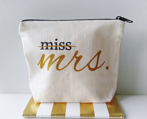 Made by DefineDesignEtc on Etsy. Available at https://www.etsy.com/listing/491089913/miss-to-mrs-canvas-makeup-bag-bride-gift