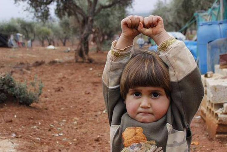 a-four-year-old-Syrian-girl-surrendered-when-a-photographer-pointed-his-camera-at-her...-and-she-assumed-it-was-a-gun.jpg
