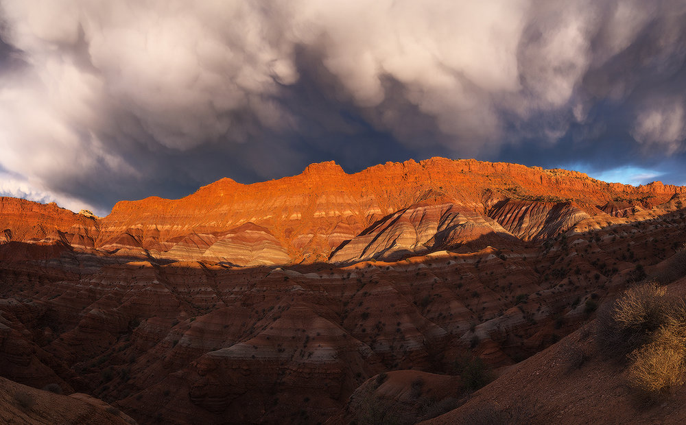 """Paria Flareup"" -- dramatic storm clouds soar over the colorful Chinle formations of Paria . Nikon D800e,  Nikon 24-85mm @ 28mm, five image panoramic stitch"