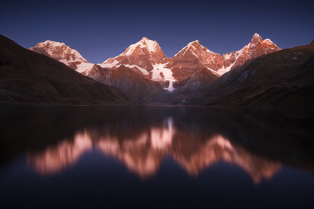 Laguna Carhuacocha at Dawn.  The immense ice-avalanche can clearly be seen in the center of the frame.  From left to right: Siula Grande (6,344 meters / 20,814 ft), Yerupajå (6,617 meters/ 21,709 ft ), Yerupajå Chico (6,089 meters / 19,977 ft), and Jirishanca (6,094 meters 19,993 ft)  Nikon D800e, Nikon 14-24mm @ 19mm, f/4.5, 20 seconds, ISO 400