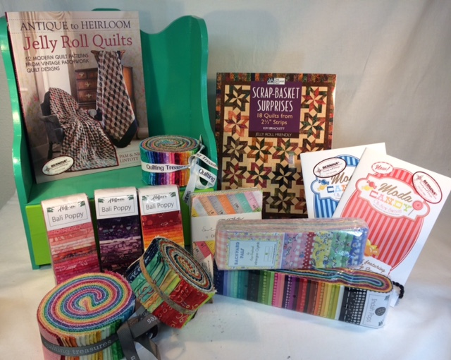 Books, l to r, are Jelly Roll Quilts, Scrap-Basket Surprises, and Moda Candy. Precuts pictured here are Bali Poppy, Moda Charm Squares, Backyard Pals, and Quilting Treasures batik strip sets.