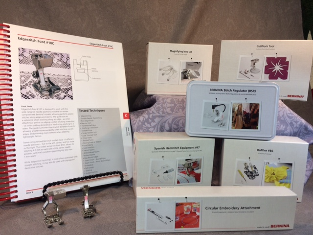 A Bernina Feetures manual, with #20D Open toe Embroidery foot, and a #10 Edgestitch foot; the Magnifying Lend set; CutWork Tool; Bernina Stitch Regulator; the Spanish Hemstitch Attachment; the Ruffler foot; and the Circular Embroidery Attachment.