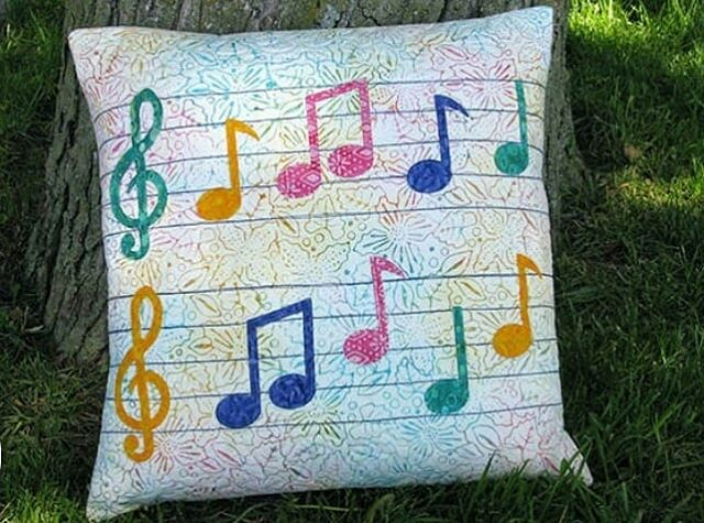 The newest Accuquilt dies have arrived in the shop and we are in love. This musical pillow was featured on the Accuquilt blog and is easily made with the Music Melody die. The musical notes are appliqued on and can either be stitched with a decorative stich of your choice or download the free embroidery software. *Photo Credit: Connecticut Kresin, Accuquilt Blogger  Find the fulll tutorial at https://www.accuquilt.com/blog/blog/tutorials/go-project-tutorials/how-to-achieve-the-amazing-musical-notes-pillow-tutorial/
