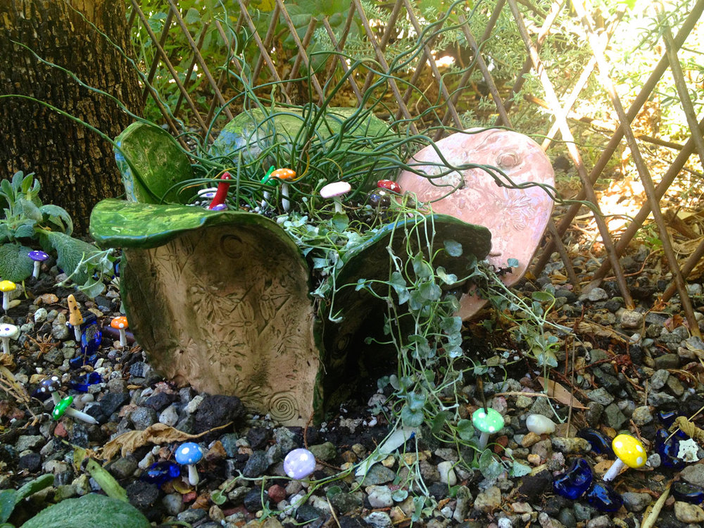 Fairy Garden planter turns a two foot space into a place to imagine and play.