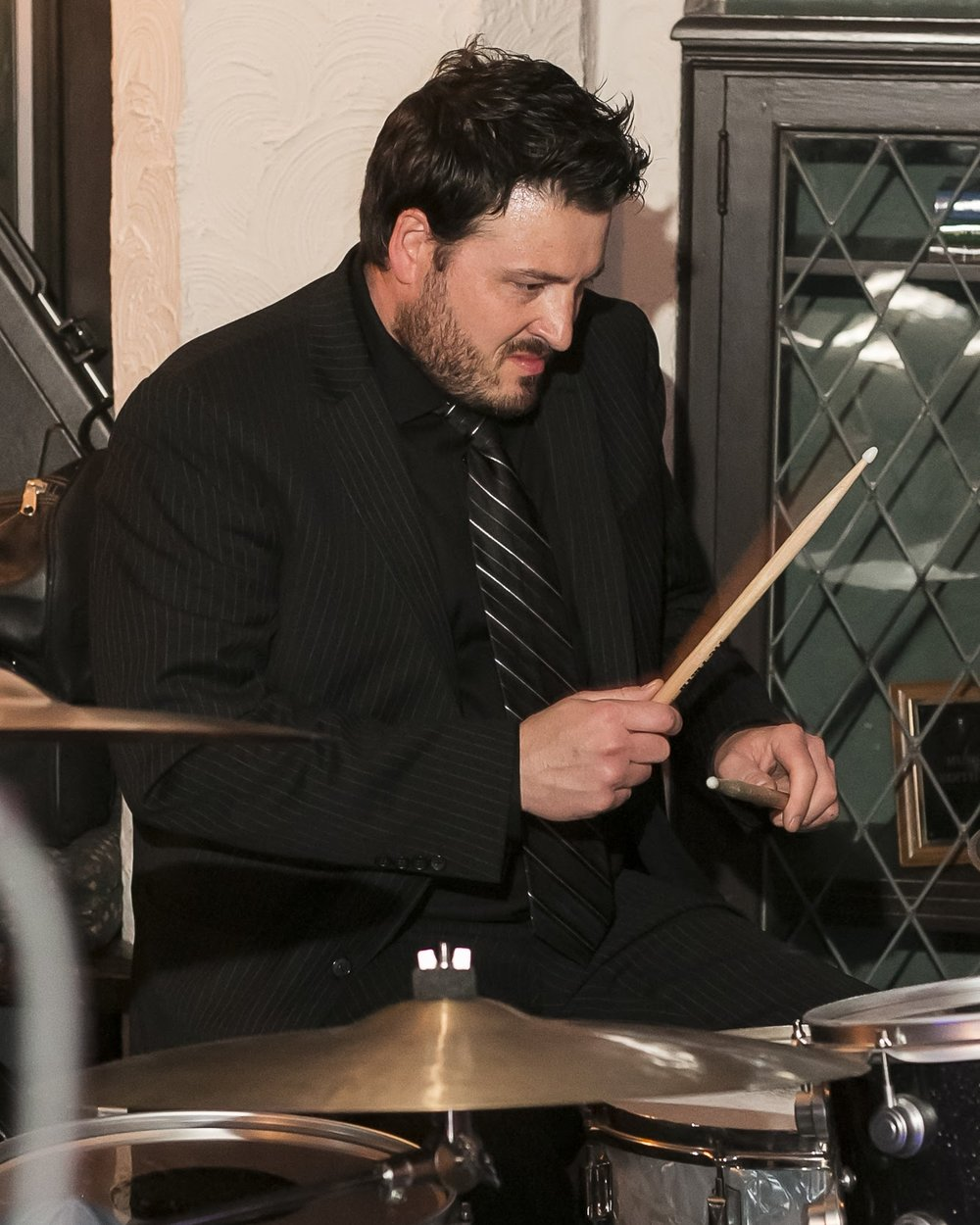 GREGG DRUMMS Our drummer. He didn't drool nearly as much as most of them we know so we kept him. He's not your buddy, friend. And he's not your guy, buddy. But he does show up on time and keep the rest of this mess from falling apart.