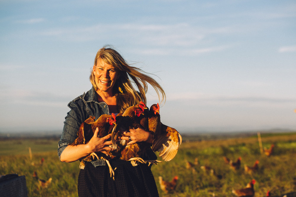 Title:  Amy Paul holding chooks, Ruby Hills Organics, Walkerville, 2016  Source:  Museums Victoria  Photographer : Catherine Forge