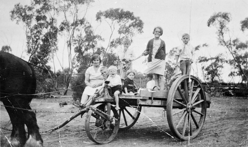 Title:  A Woman and Children on a Three-Wheeled Cart, Agriculture, Kurnwill, Victoria, circa 1930: The Biggest Family Album in Australia  Source:  Museums Victoria  Photographer : Unknown