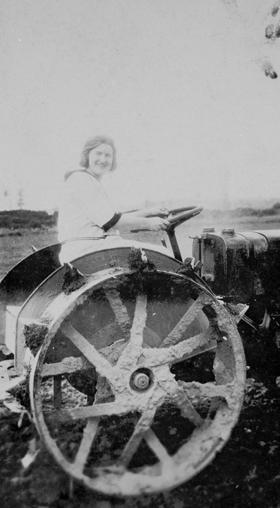 [Photograph 3]: Original keywords used to catalogue the photo; agricultural equipment, tractors. Image attribution: A women sitting on a tractor, Yarraby, Victoria, 1930, Source: Museums Victoria, MM5538, Photographer: Unknown