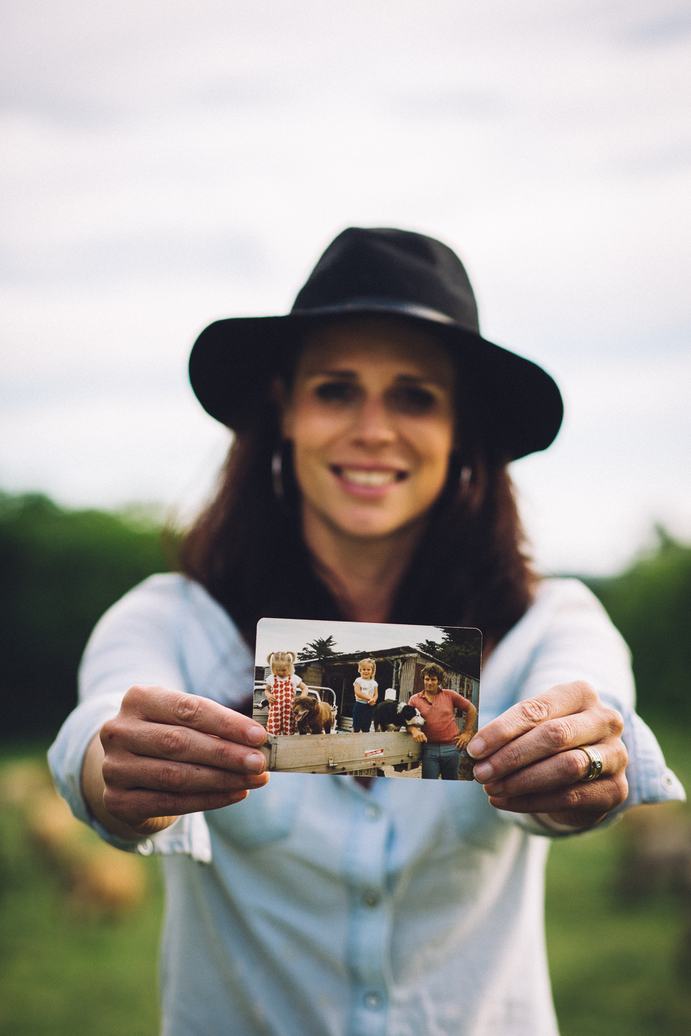 Sallie Jones of  Gippsland Jersey  holding a photo from her childhood depicting her father Michael Bowen, Jindivick, 2016, Source:  Museums Victoria , Photographer:  Catherine Forge
