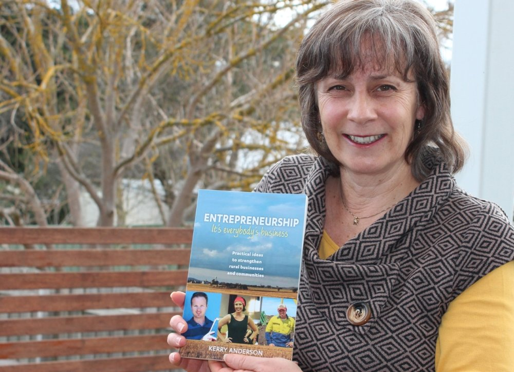 Kerry Anderson holding her book, 'Entrepreneurship: It's Everybody's Business', image: supplied.