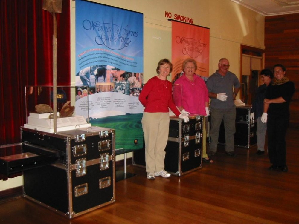 Liza-Dale Hallett (far left), Rhonda Diffey, a member of the Women on Farms Heritage Group (second from left), Alan Rendell (third from left), Merlyn Rendell (second from right) and Georgia Harvey (far right) working on the Museum Victoria Heritage Displays, Women on Farms Gathering at Horsham, 2004, Source: Museums Victoria, MM90816