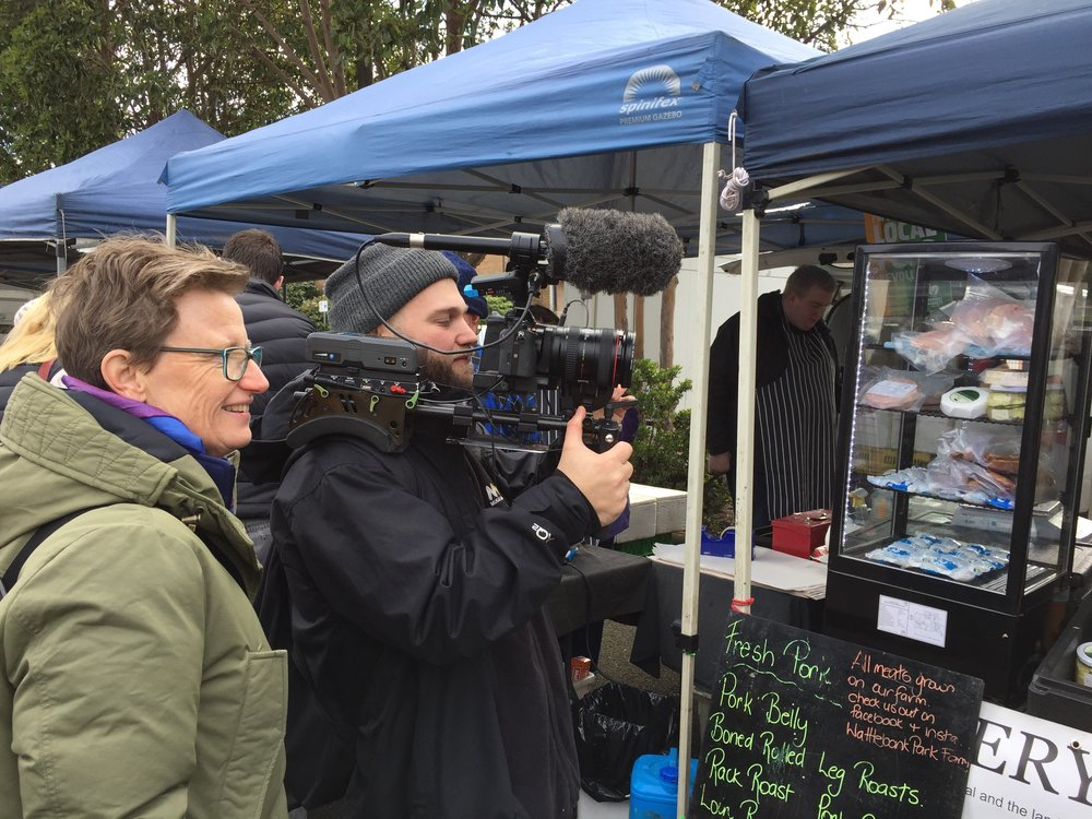 Liza Dale-Hallett (left) and Robert Zugaro (right) filming for the Invisible Farmer Project at the Warragul Farmers Market, 2017, Source: Supplied, Catherine Forge