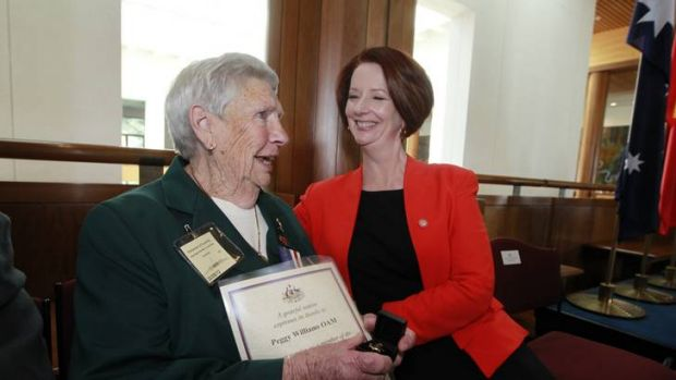 Prime Minister Julia Gillard presenting AWLA servicewoman Peggy Williams with a commemorative brooch, 2012, Photograph: Andrew Meares, Photography courtesy Fairfax media.
